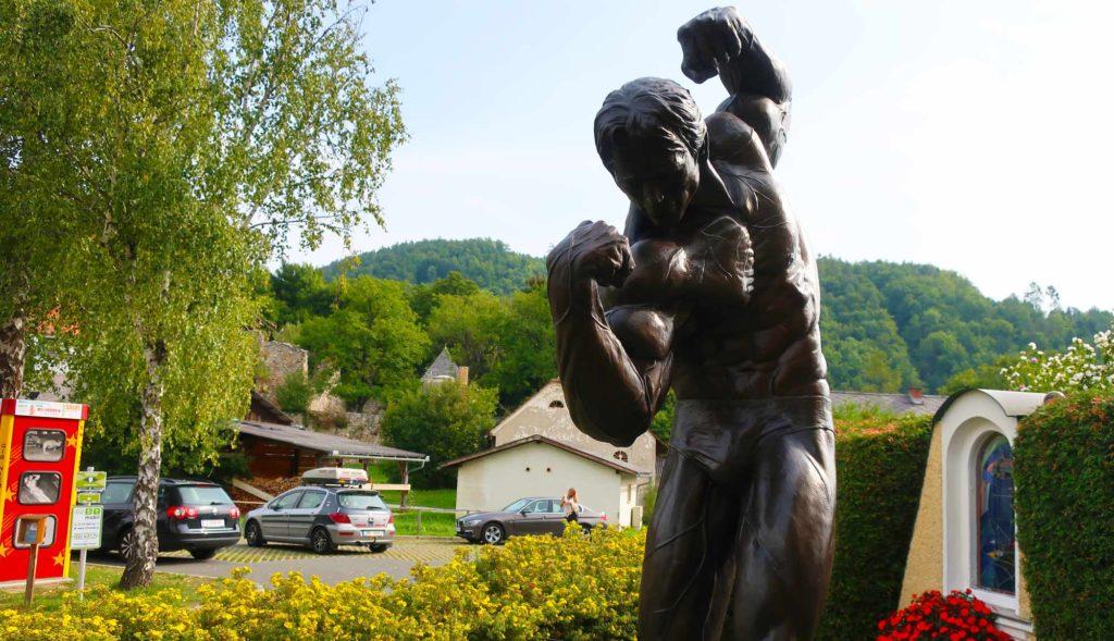 Statue flexing